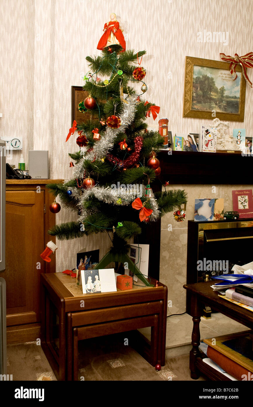 Small Christmas Tree In A Living Room On A Small Wooden Table Stock Photo Alamy