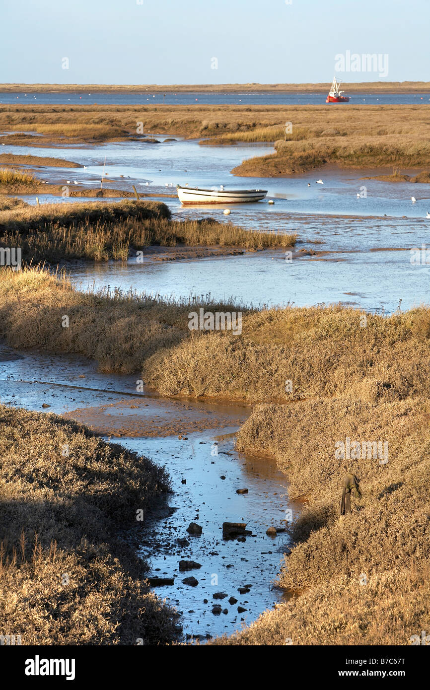 BRANCASTER STAITHE NORTH NORFOLK BOAT TIDAL MARSH MUD WATER SEA - Stock Image