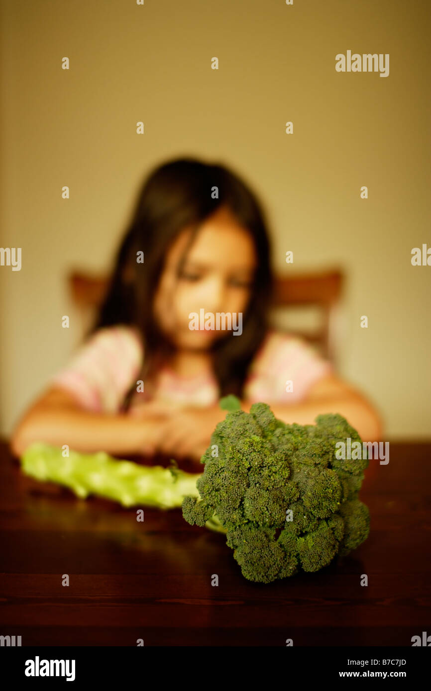 Five year old girl with Broccoli - Stock Image