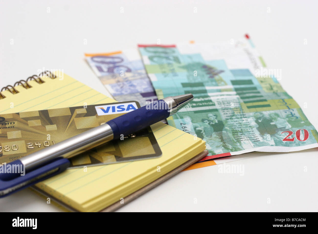 New Israeli Shekel Bank notes with pen Credit Card and notebook Stock Photo