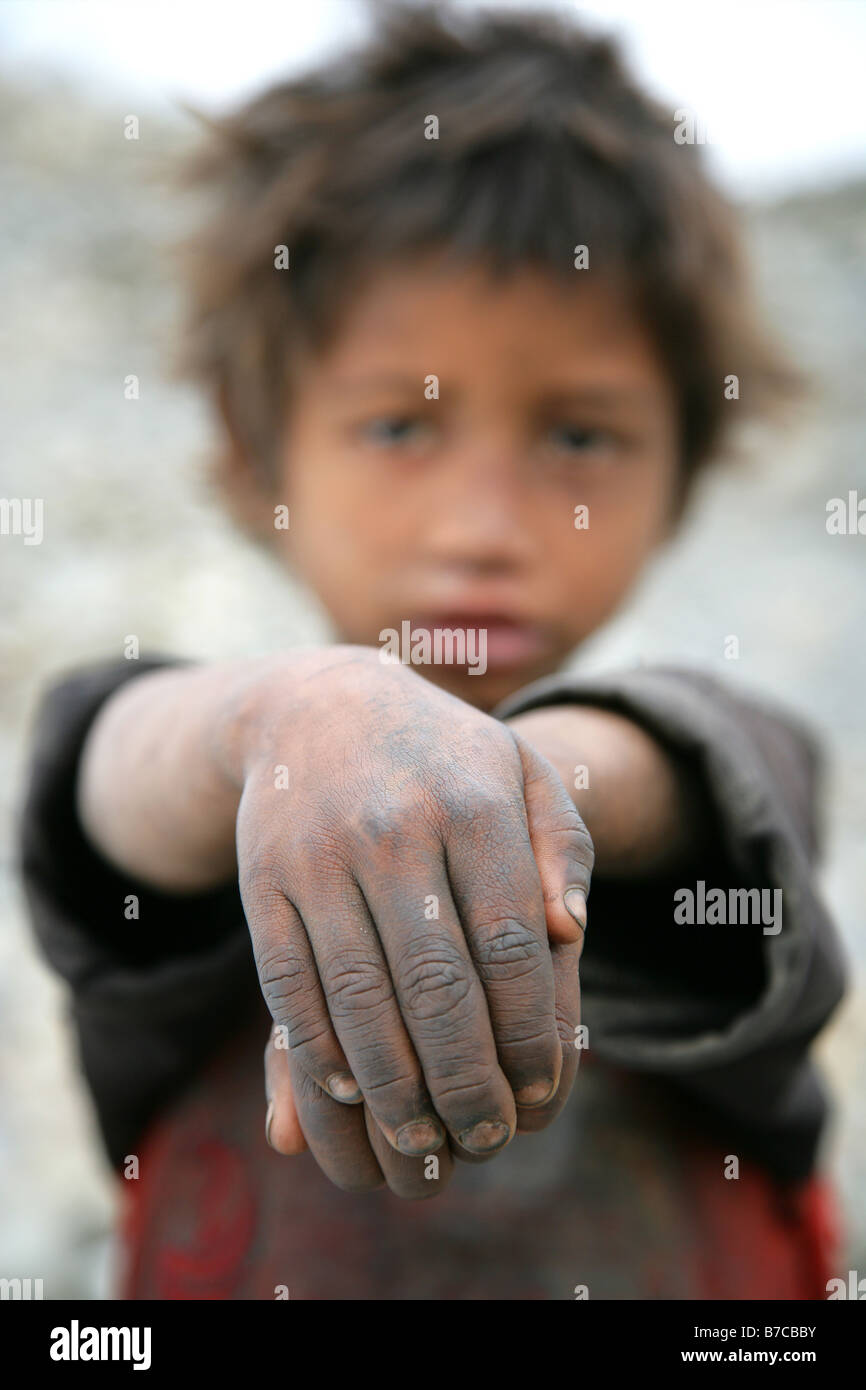 Nepalese boy with filthy hands - Stock Image