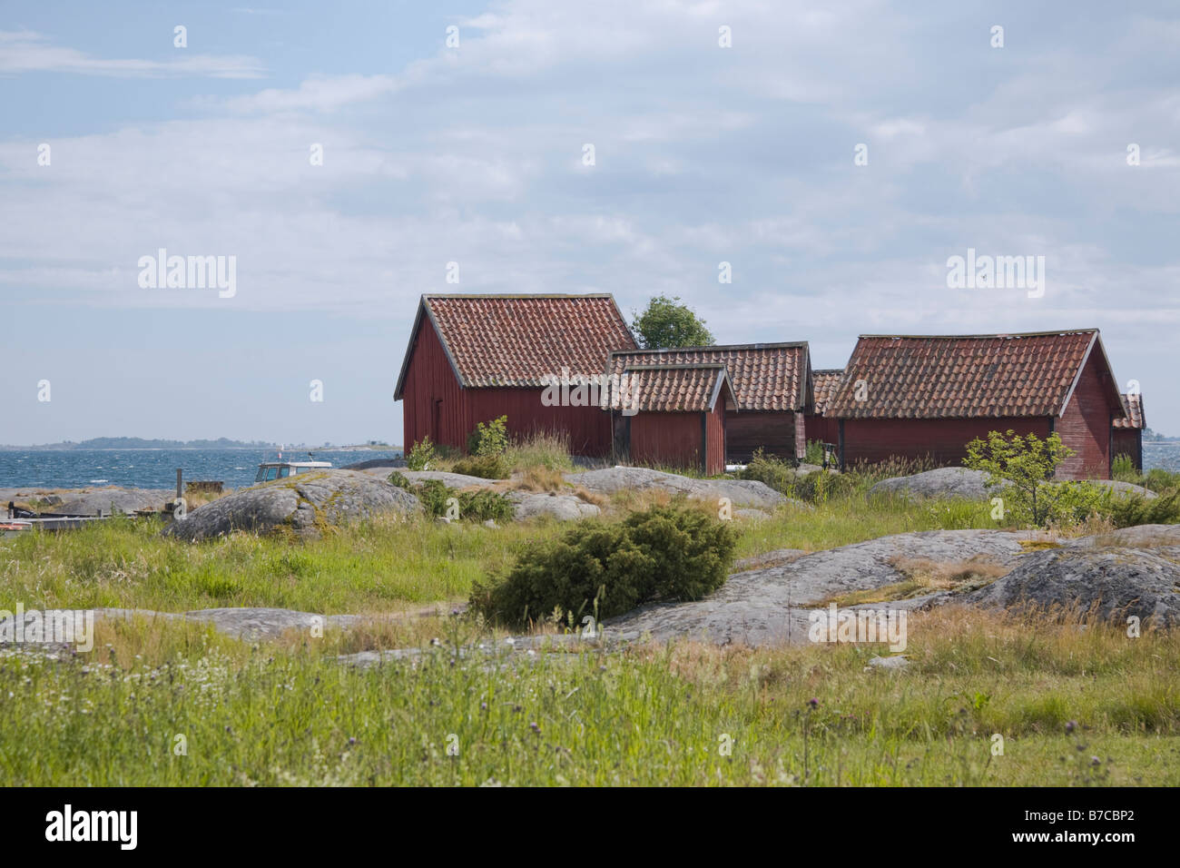 Traditional red painted fisherman's huts on the island of Svartloga in the 'Archipelago of Stockholm', - Stock Image