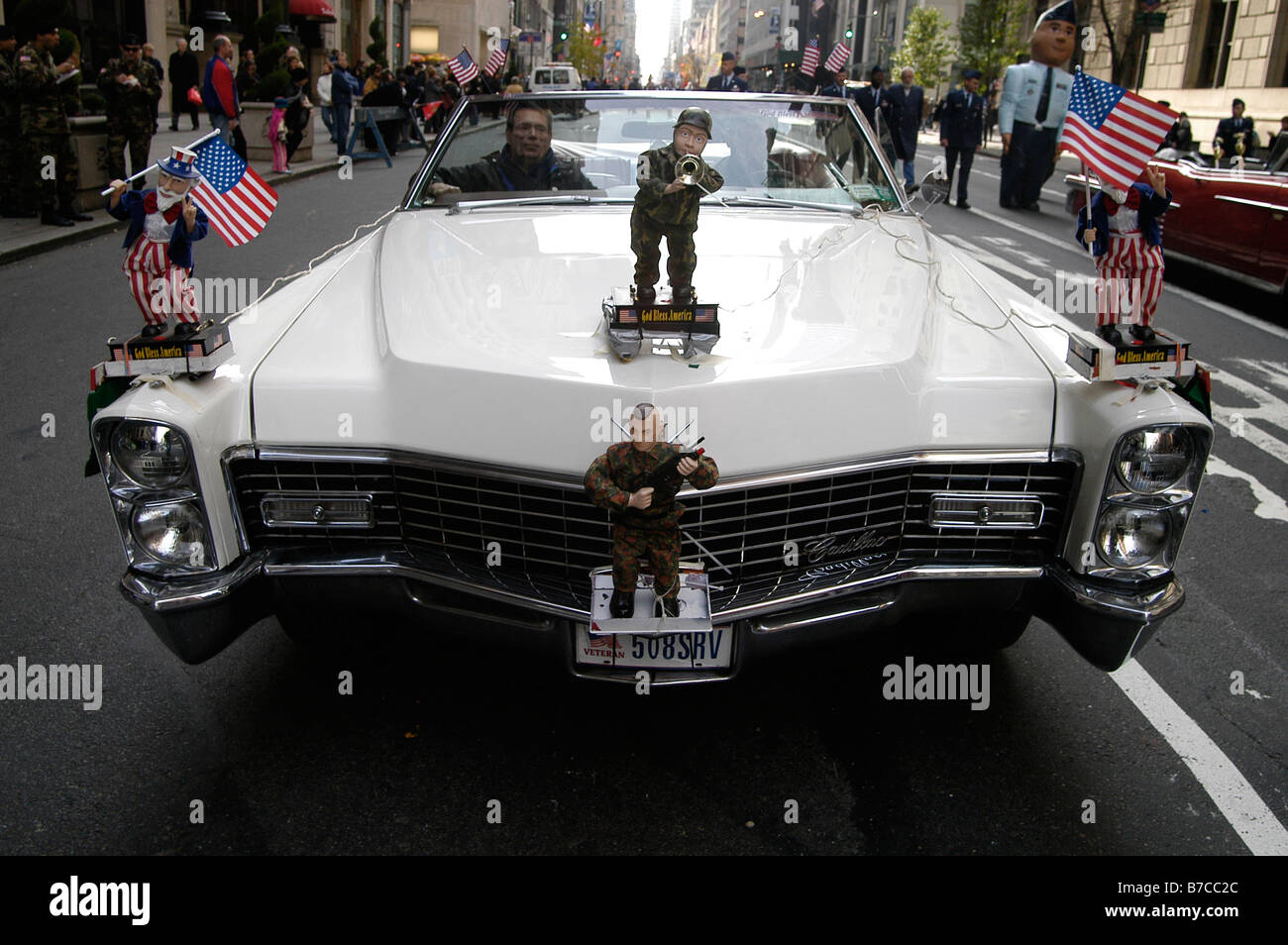Veterans of American wars in their open top classic American car partake in the Veterans Day Parade in Manhattan, Stock Photo