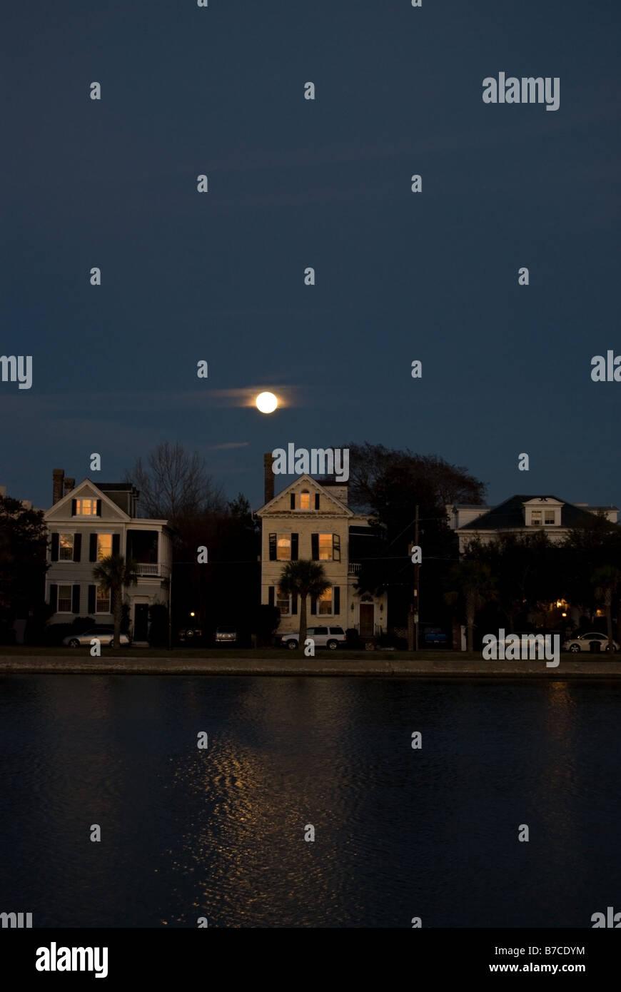 The moon rising over Charleston, South Carolina's Colonial Lake. - Stock Image