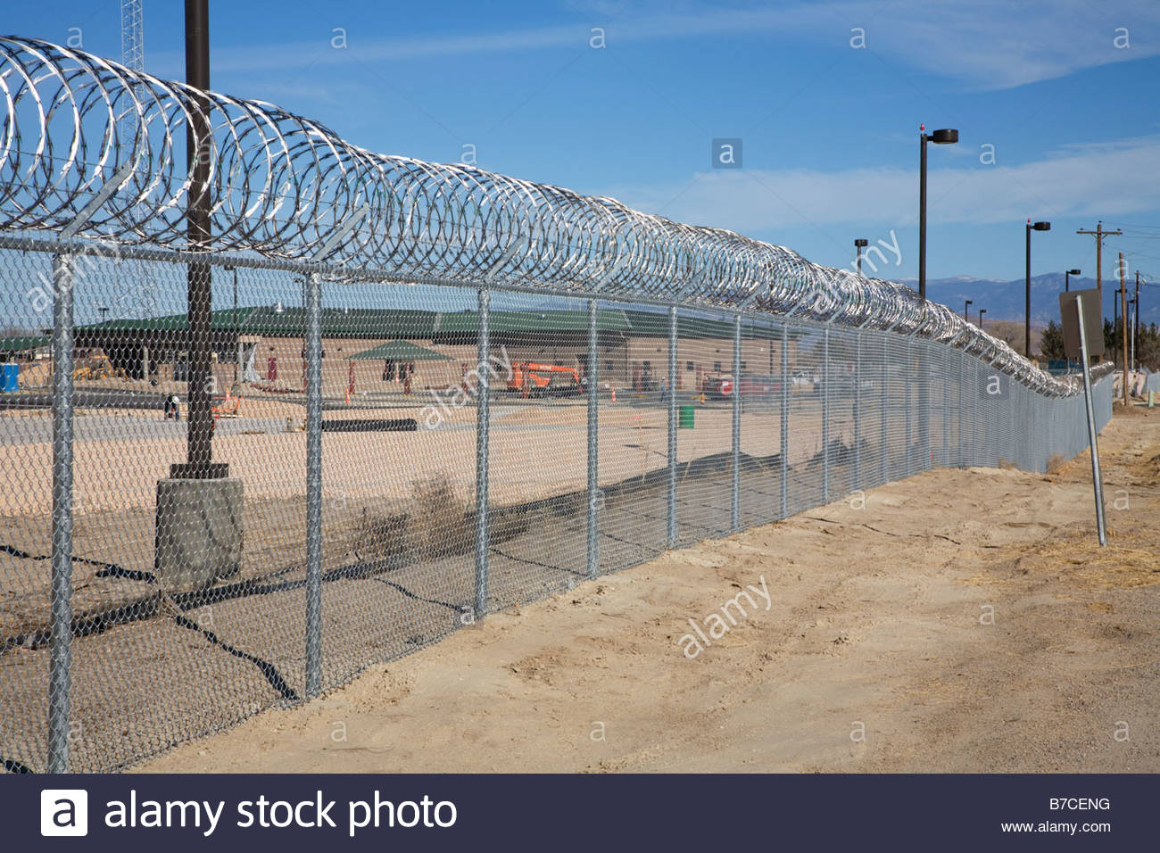 Razor wire concertina wire topping security fence Stock Photo ...
