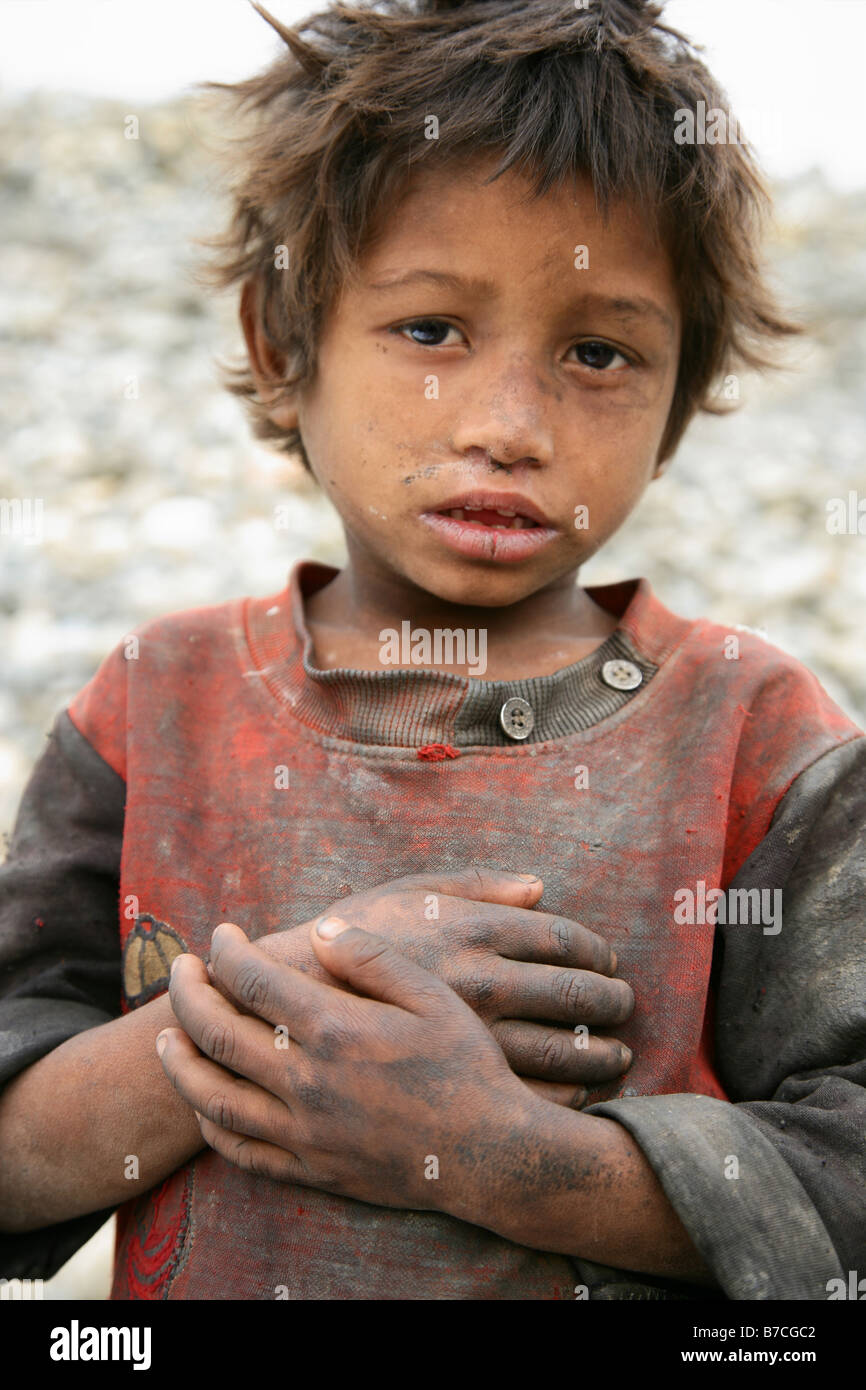neglected Nepalese boy Sunil - Stock Image