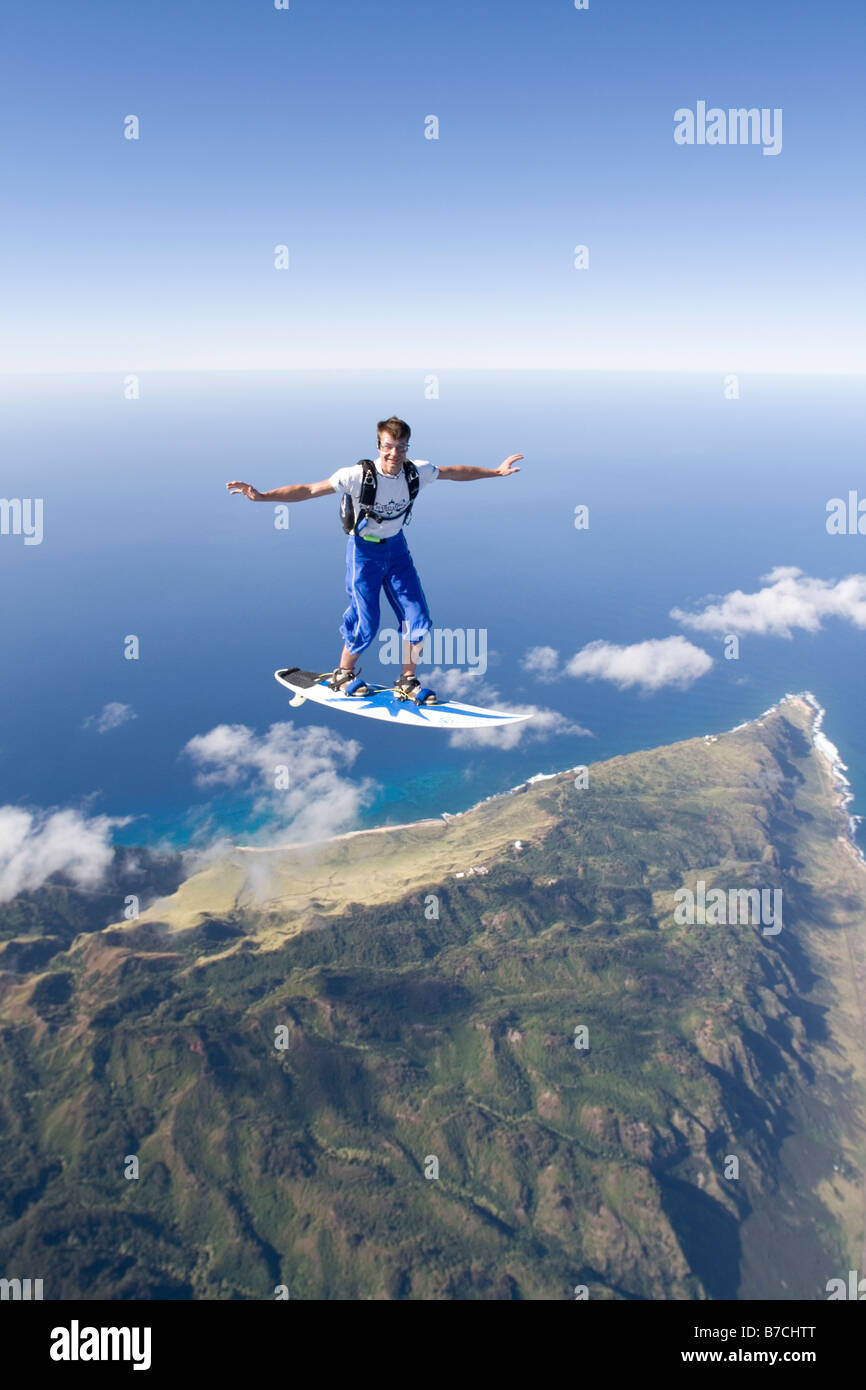 Skydiver Is Surfing The Clouds Over Oahu Hawaii Usa With A