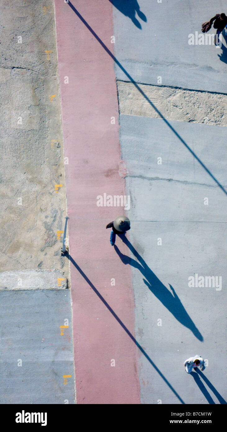 Aerial view of people walking on concrete ground shadows elongated Buyukcekmece Istanbul Turkey - Stock Image
