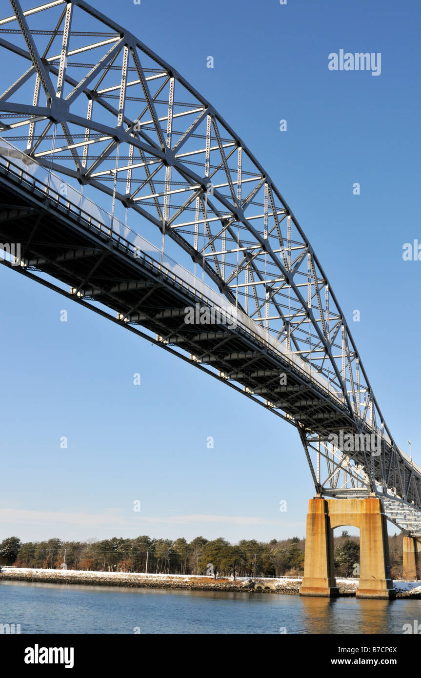 Bridge over Cape Cod Canal showing steel girders and trusses and concrete pylons - Stock Image