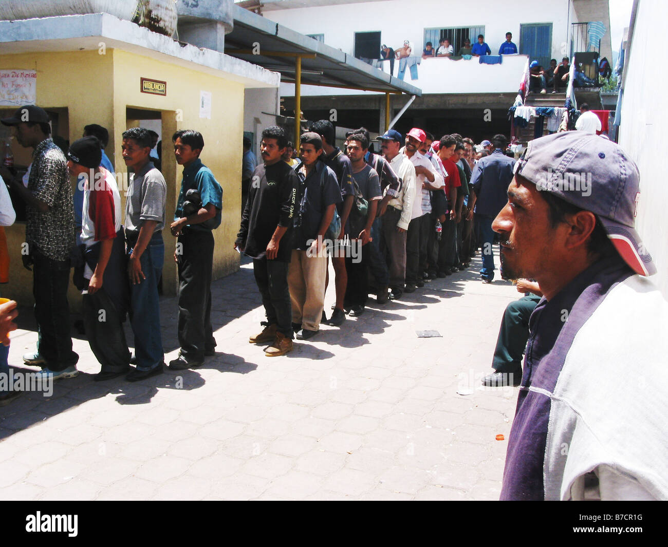 Illegal immigrants in a hostel making a break on their way to the U.S. and waiting for a warm meal, Mexico - Stock Image
