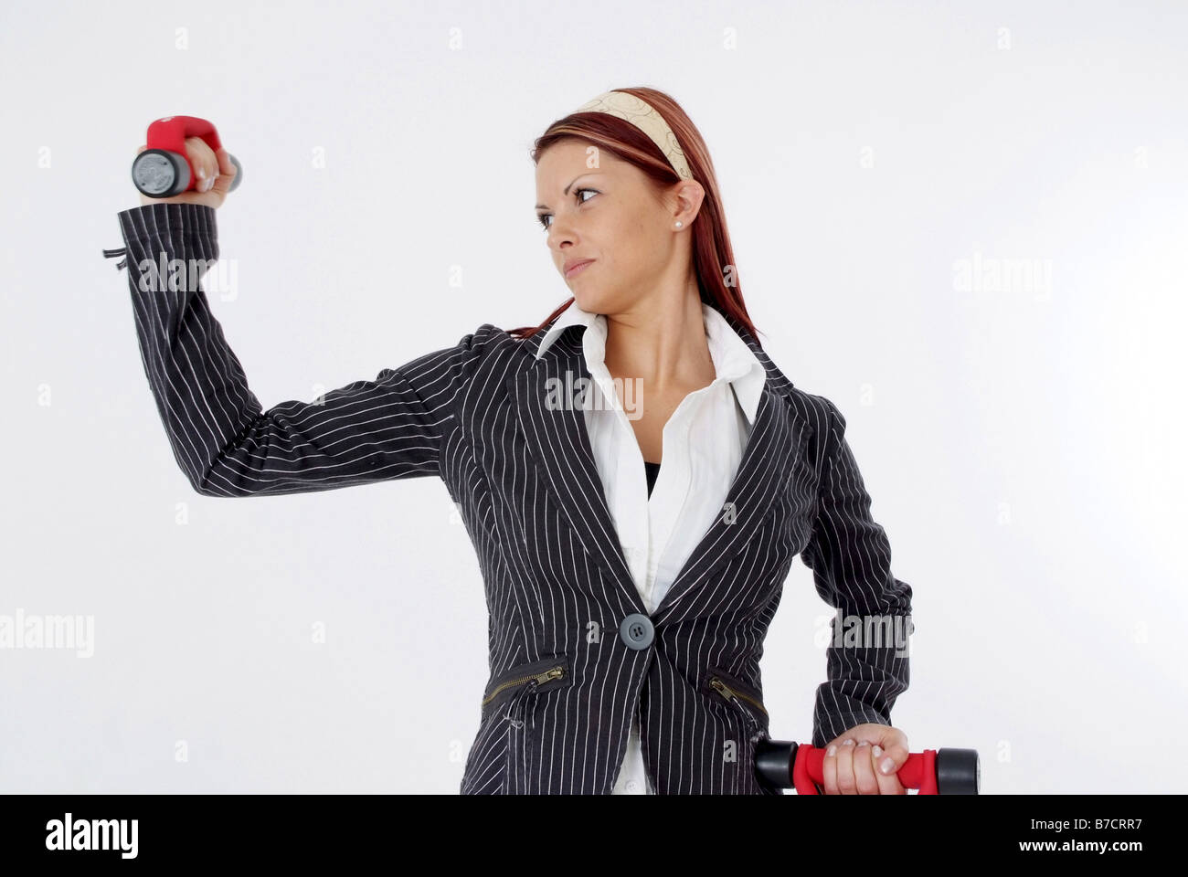 businesswoman with dumbbells - Stock Image