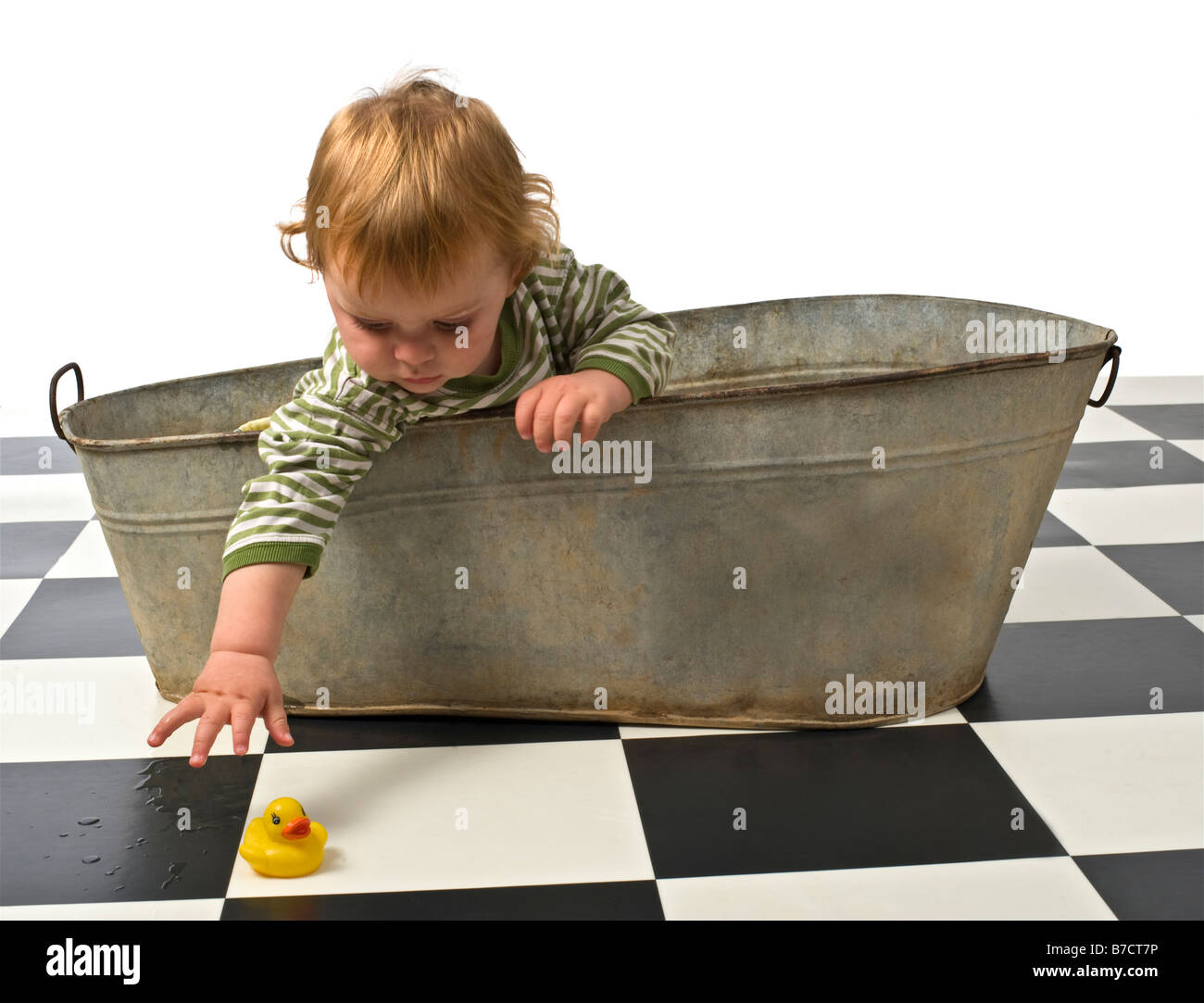 baby in an old bathtub with rubber duck Stock Photo: 21795418 - Alamy