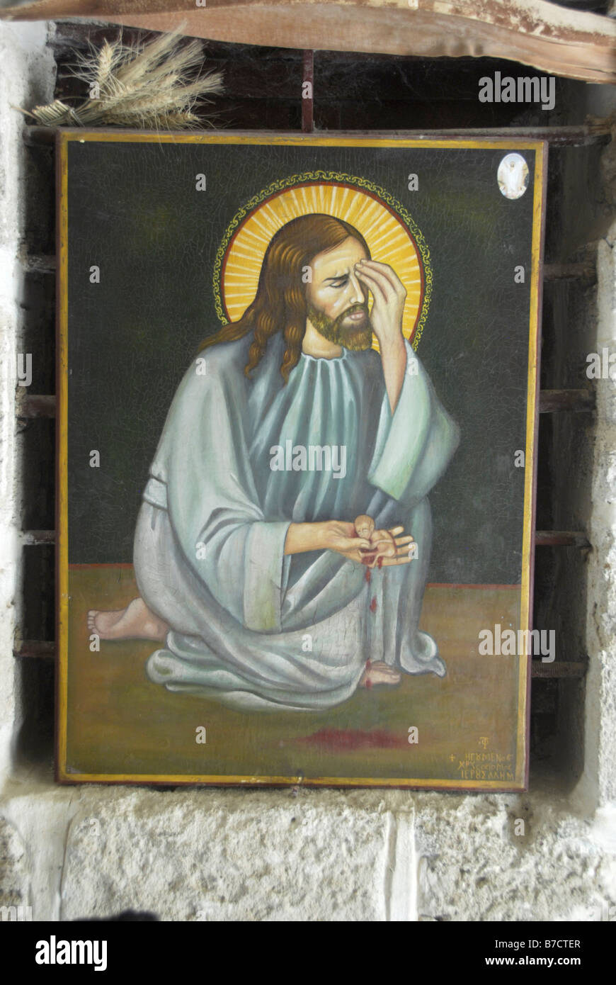 Icon of Jesus Christ in Greek Orthodox Monastery of St. Gerasim in Jericho crying over abortions Stock Photo