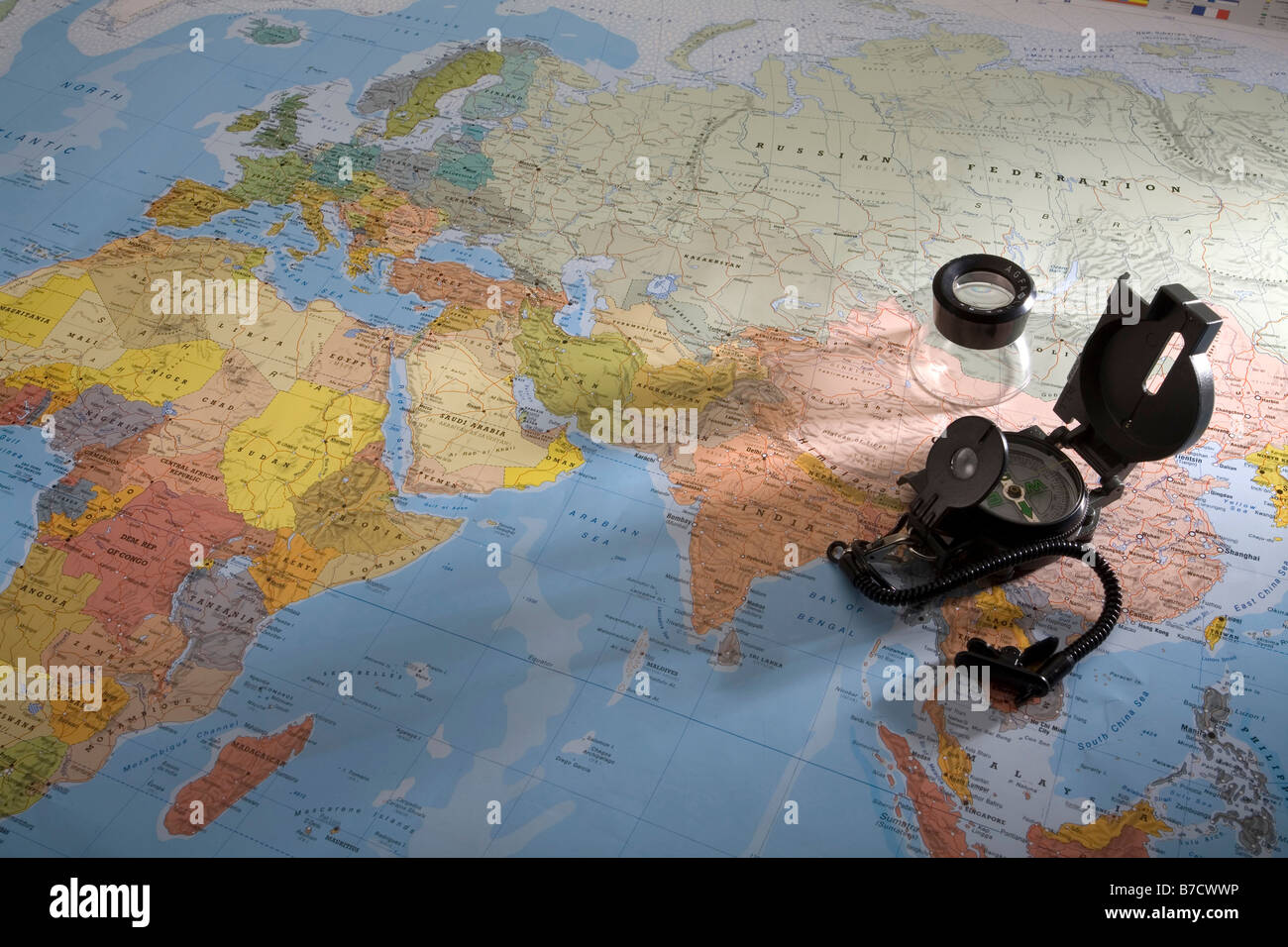 World map showing africa europe and asia with military compass and world map showing africa europe and asia with military compass and magnifying glass gumiabroncs Image collections