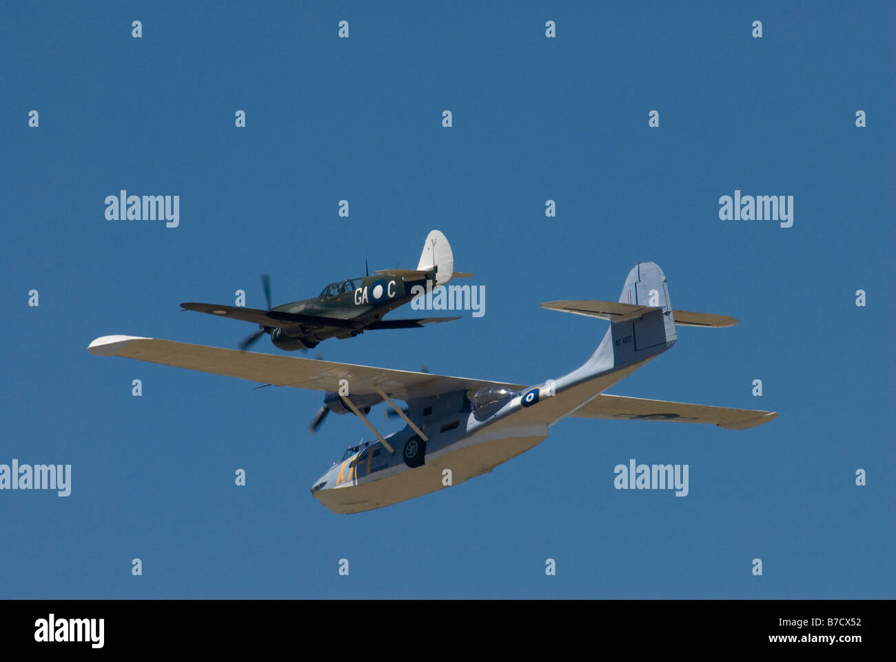 PBY-5A Catalina amphibious flying boat with Curtiss P40 Kittyhawk fighter escort - Stock Image
