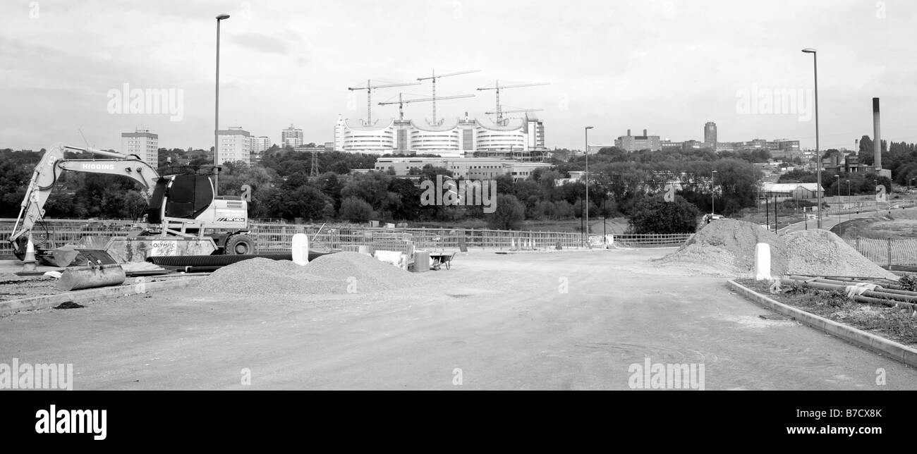 The new Queen Elizabeth Hospital under construction rear from the new Harborne Lane access road, also under construction. - Stock Image