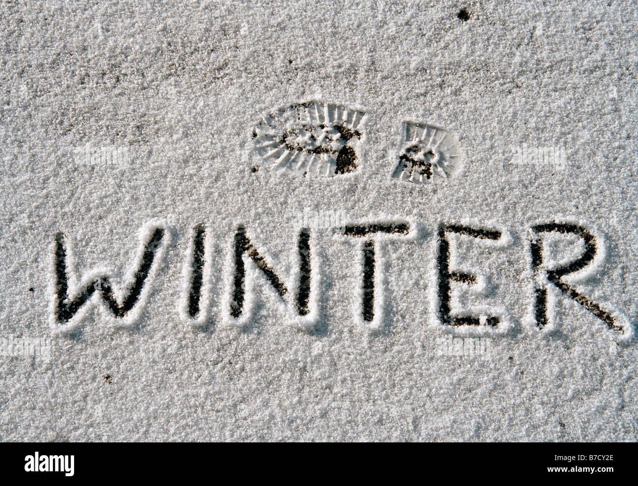'Winter' written in snow - Stock Image