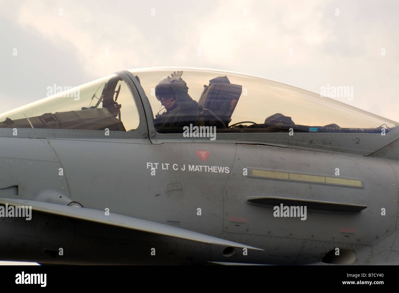 Close up of the cockpit and pilot of a Eurofighter Typhoon military jet fighter plane at Biggin Hill Airshow Stock Photo