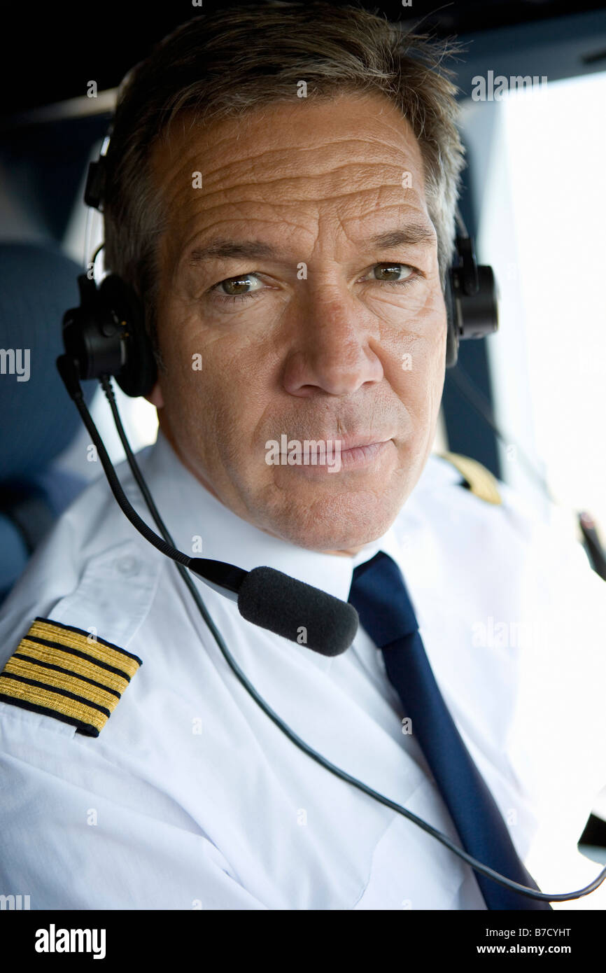 A pilot in a cockpit - Stock Image