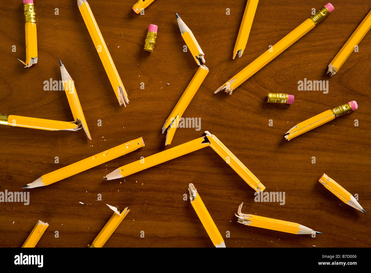 A desk littered with broken pencils - Stock Image
