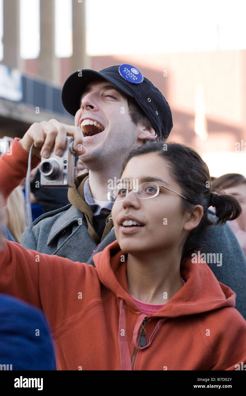 An interracial couple take photographs and watch the inauguration of Barack Obama at the University of California - Stock Image