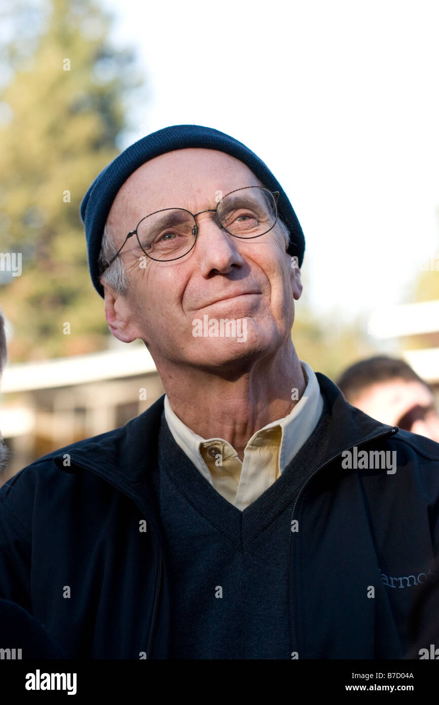 An elderly gentleman watches the inauguration of Barack Obama on the Jumbotron at the University of California at - Stock Image