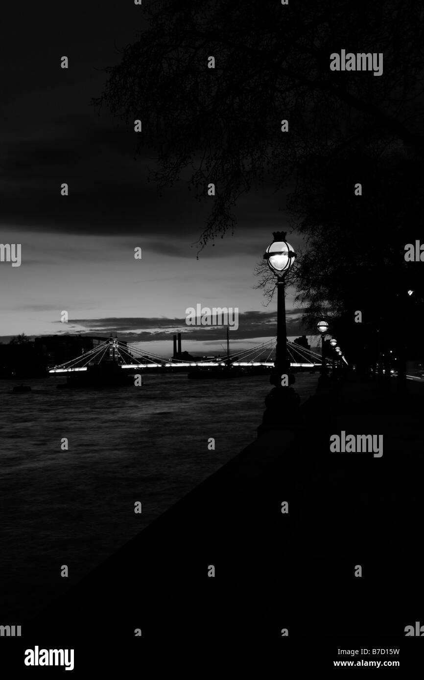 View up the River Thames towards Albert Bridge, Chelsea, London - Stock Image