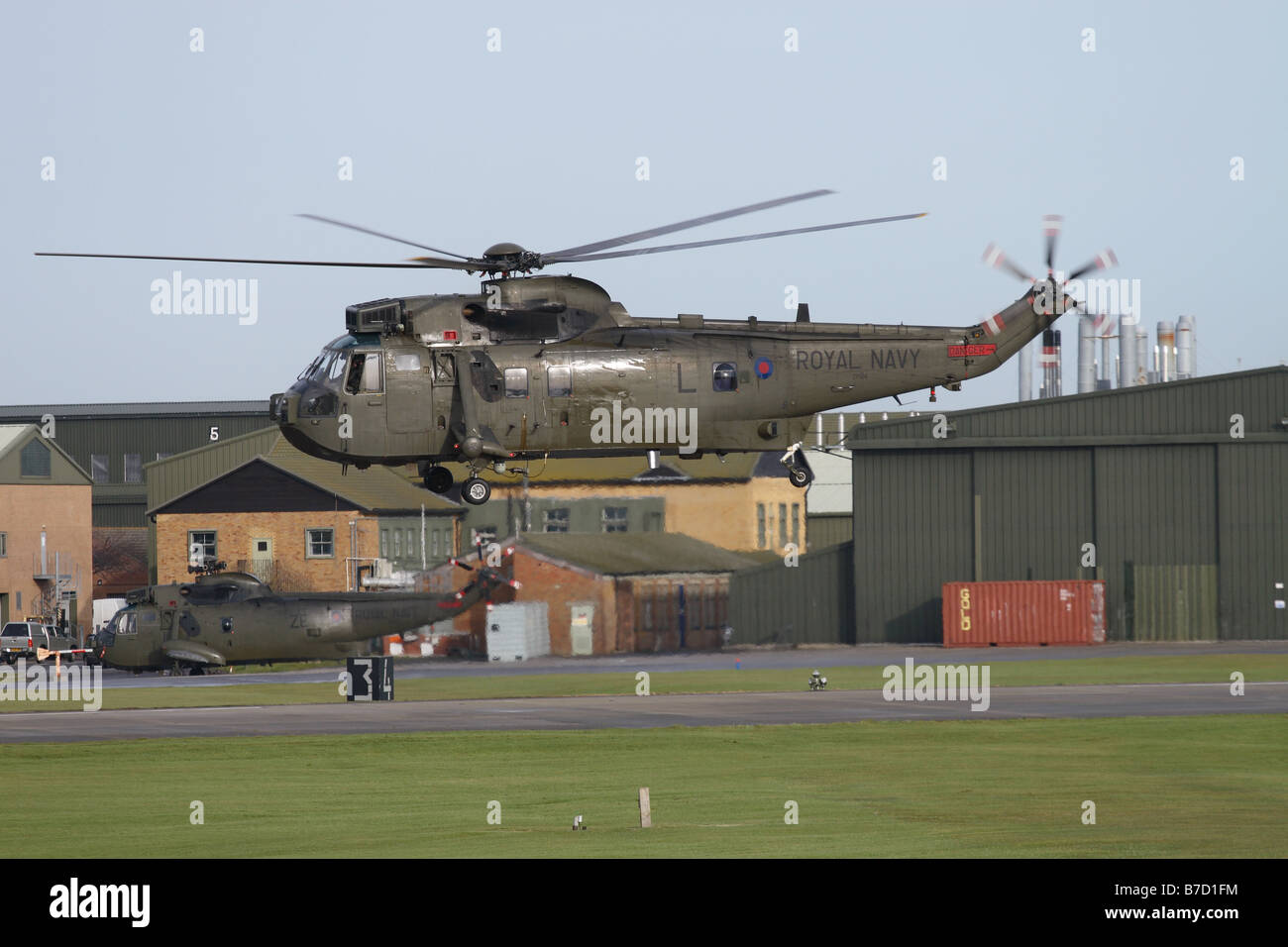 British Royal Navy Westland Sea King HC4 troop carrying helicopter taking off at RNAS Yeovilton Somerset in January - Stock Image