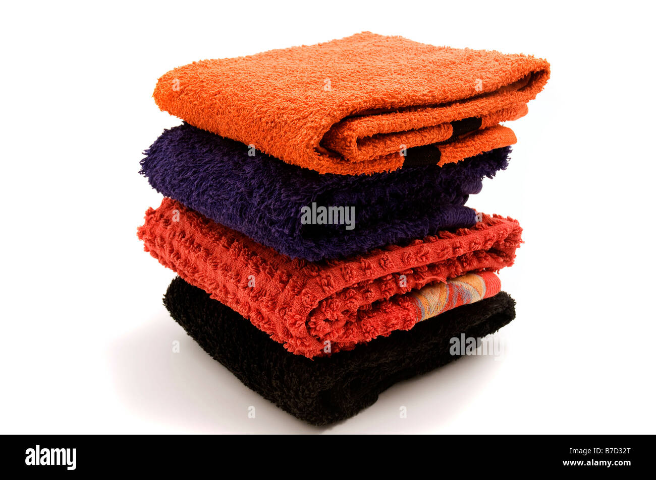 Piled towels on a white background - Stock Image