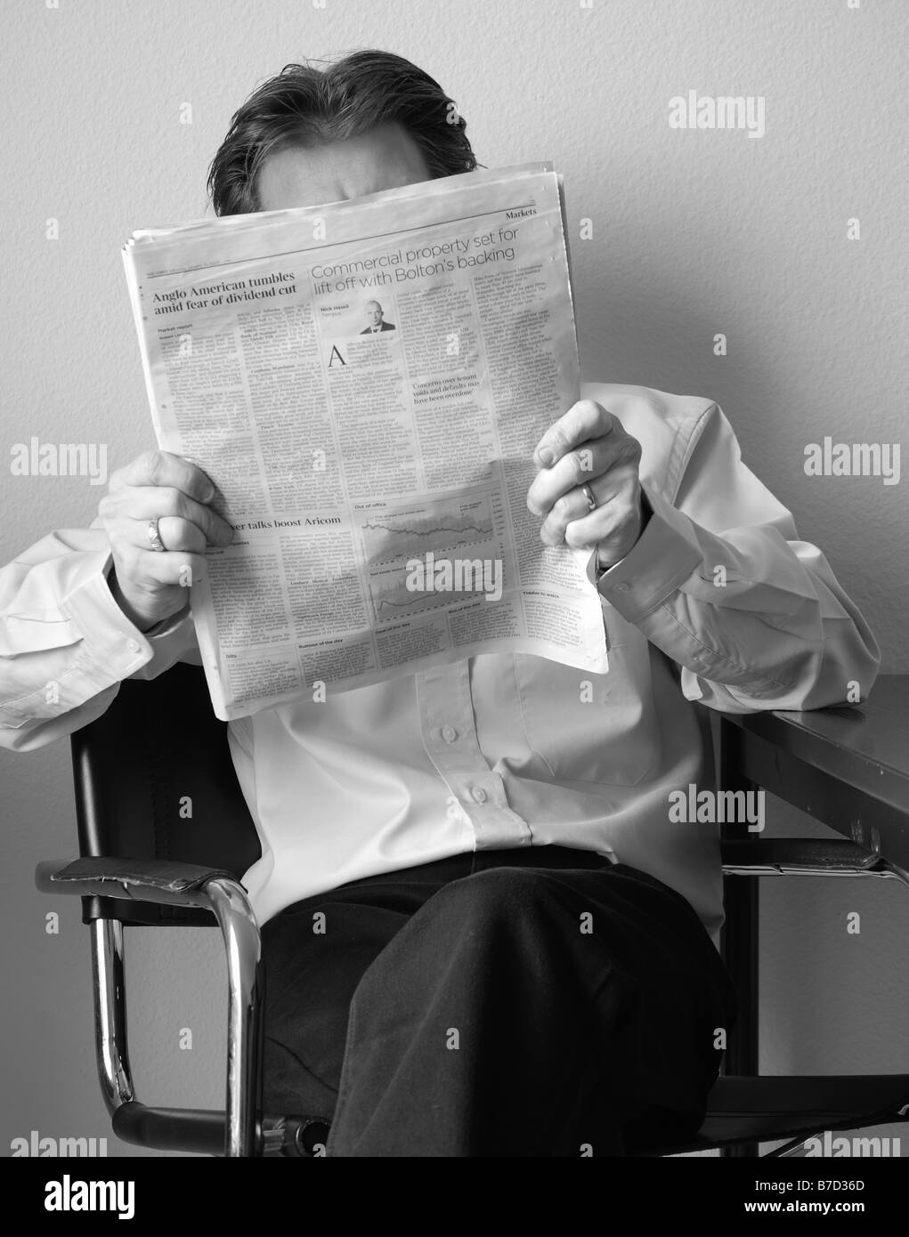 Image reflecting the credit crunch crisis within the bank system the effect on business, stock market and the man Stock Photo