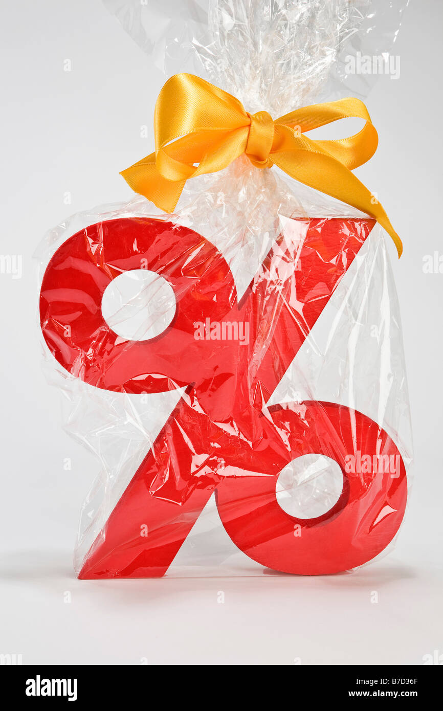 Percentage sign wrapped in plastic and tied with a bow - Stock Image