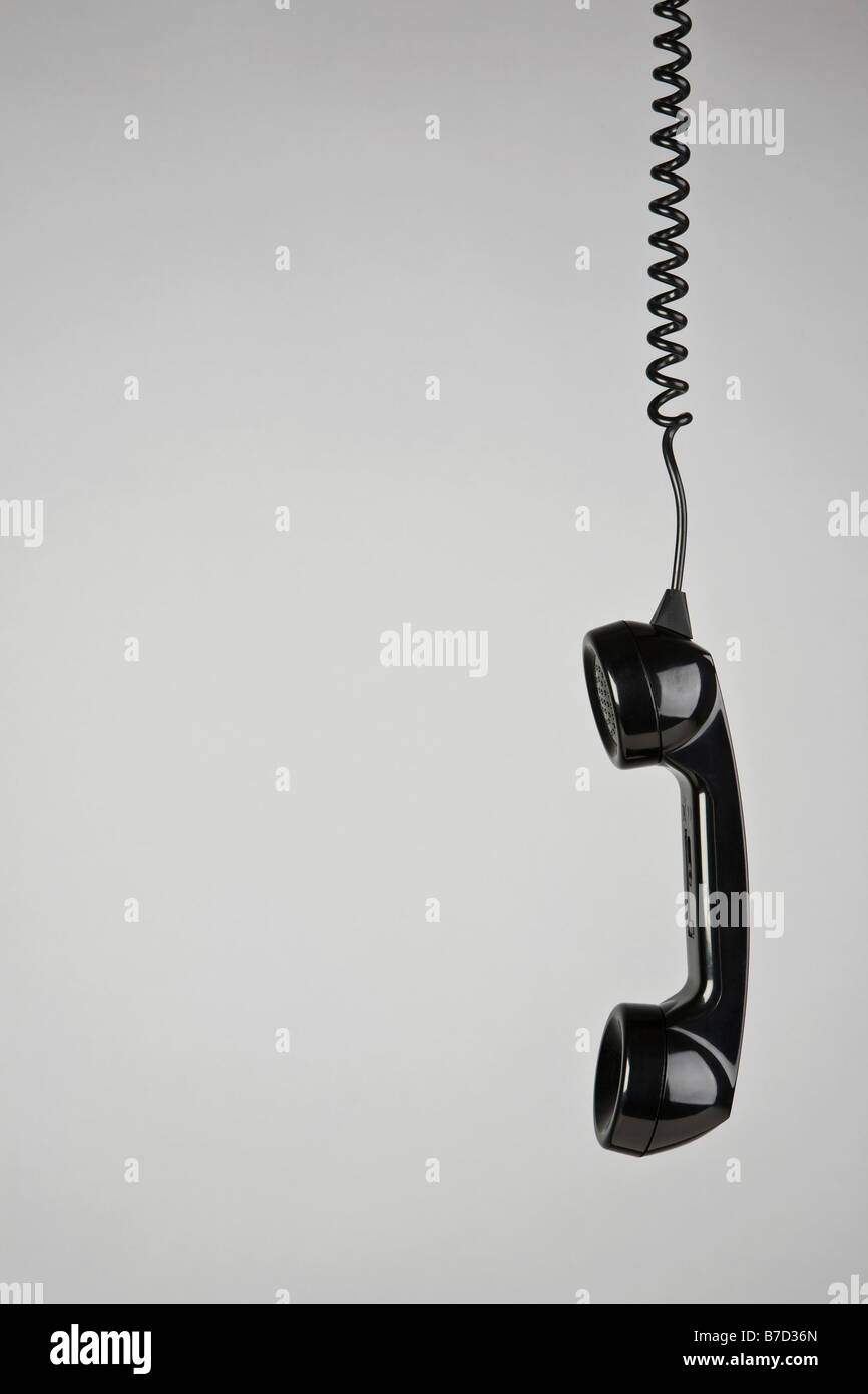 A telephone receiver hanging - Stock Image