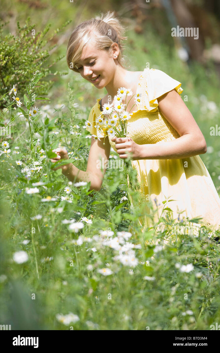 Young girl picking flowers Stock Photo