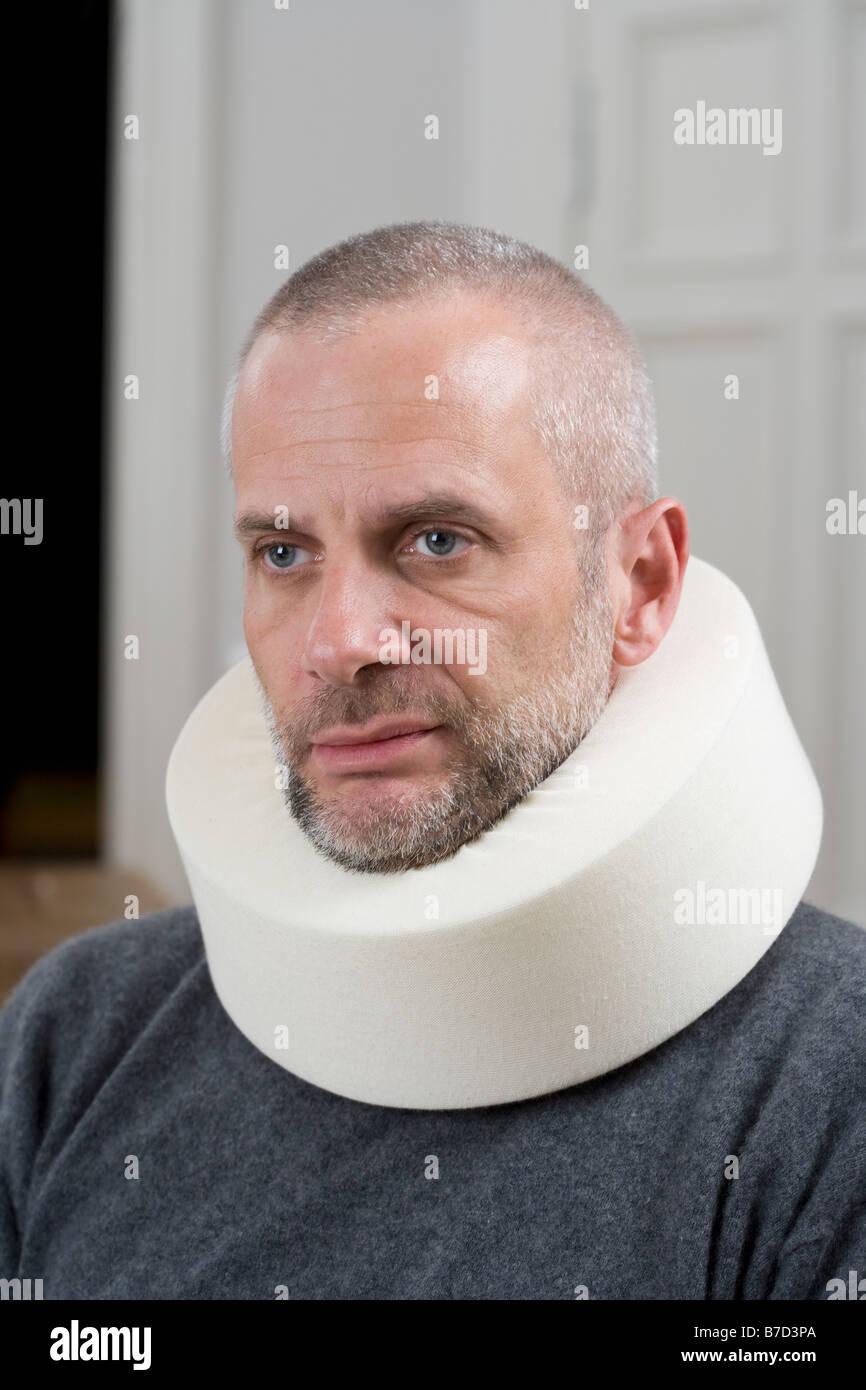 A man wearing a neck brace - Stock Image