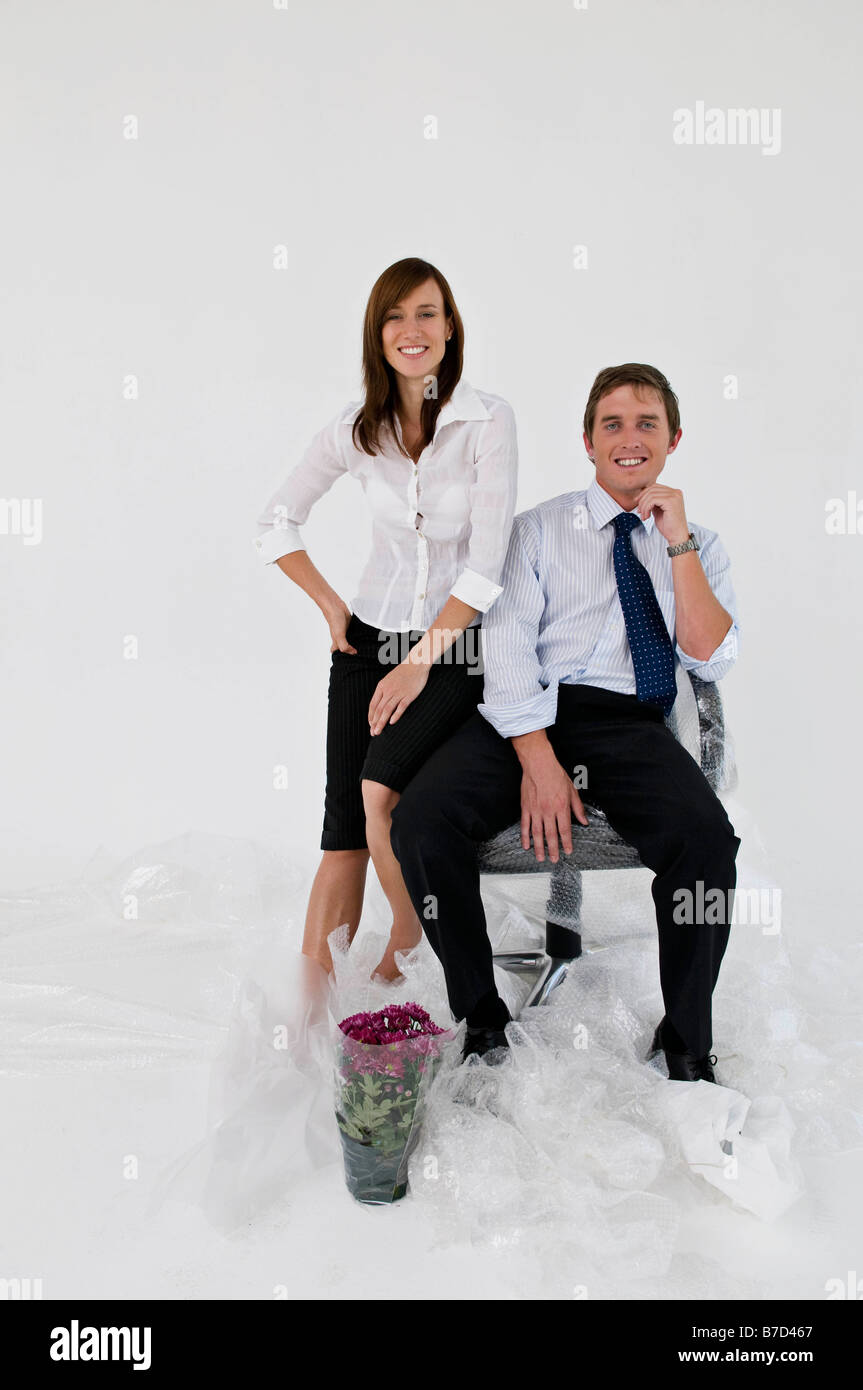 A business couple in a new office. - Stock Image