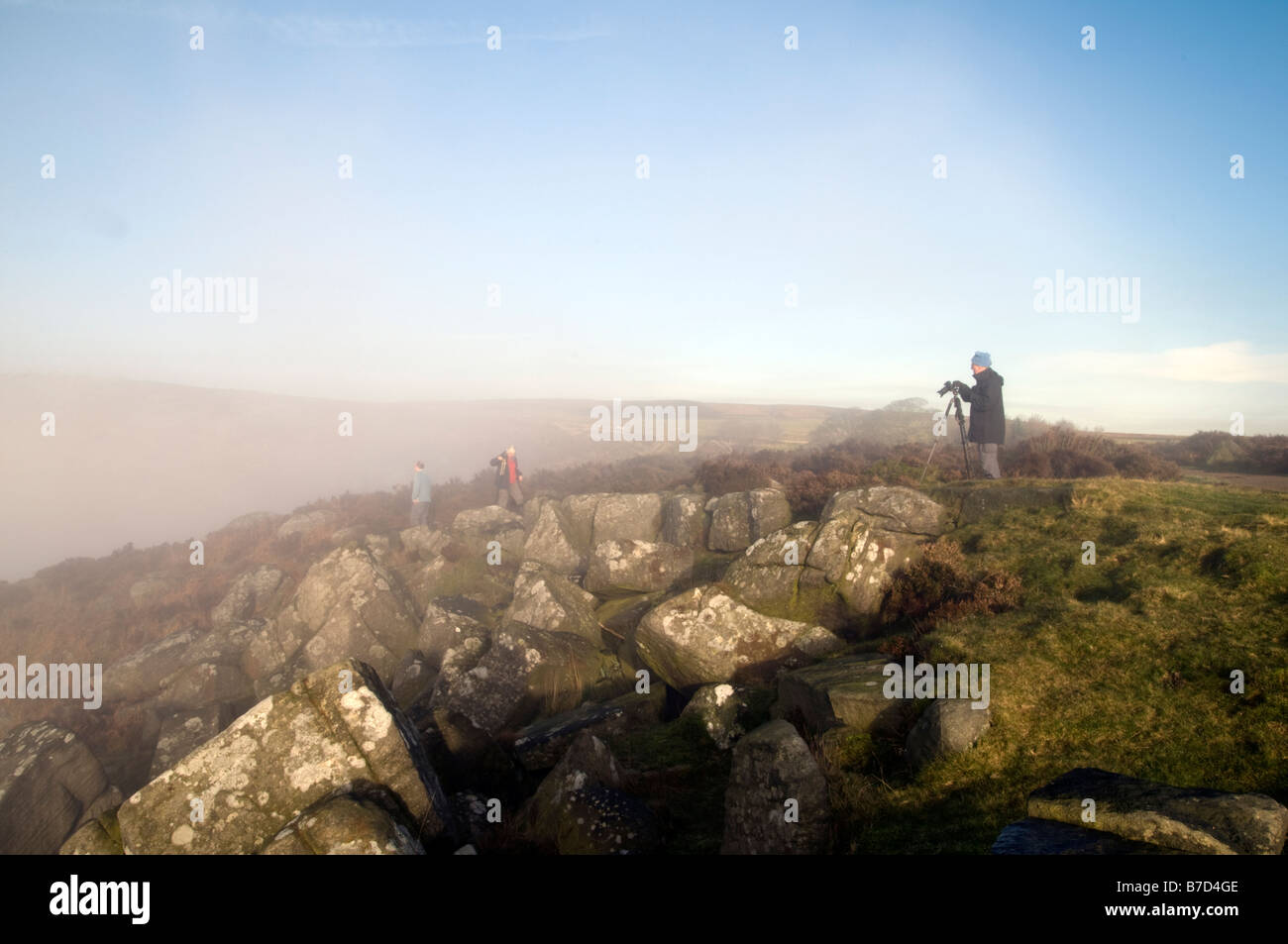 Photographers taking pictures on a misty morning on Curbar Edge Peak District Derbyshire England - Stock Image