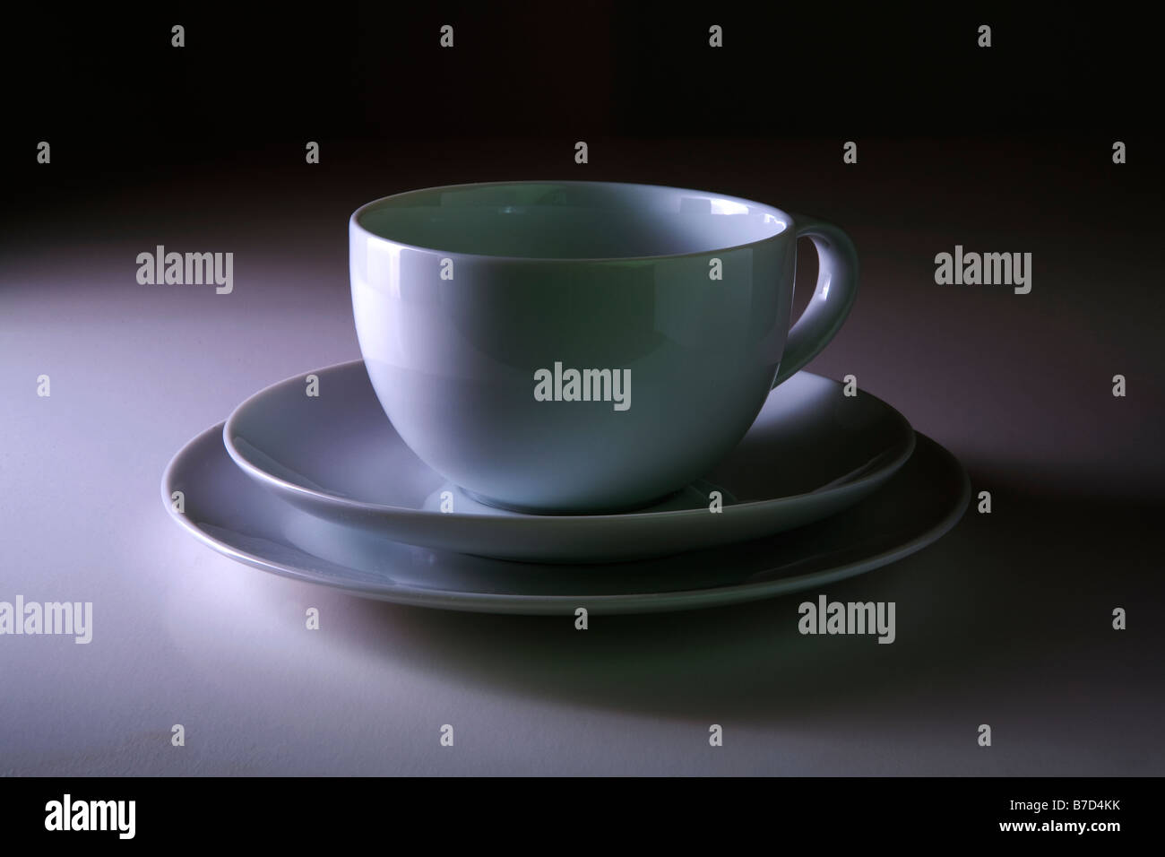 cup saucer side plate white crockery - Stock Image
