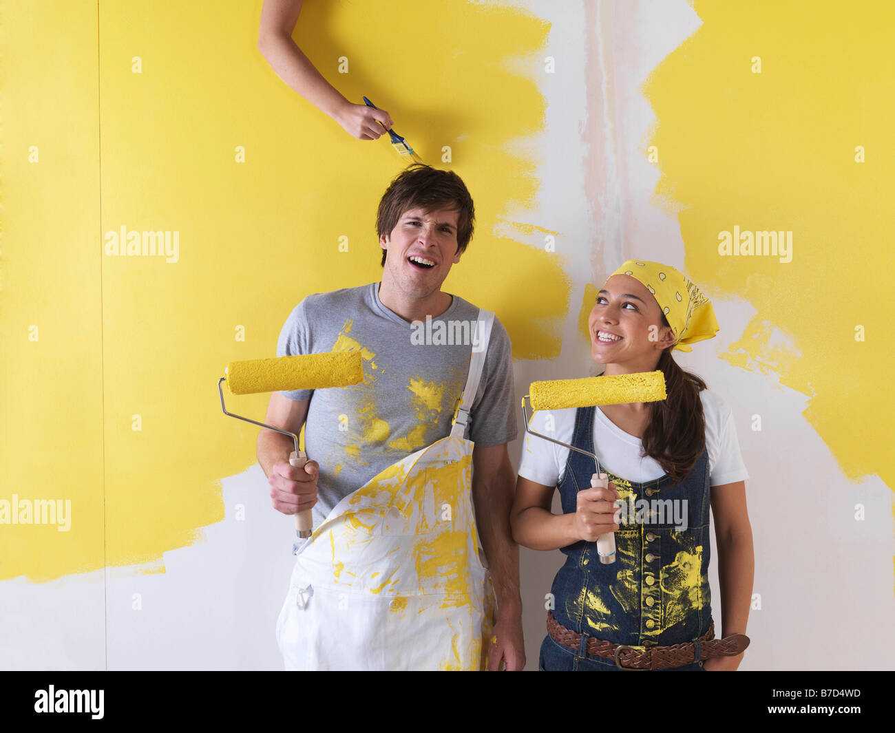 Couple messing around with paint. - Stock Image