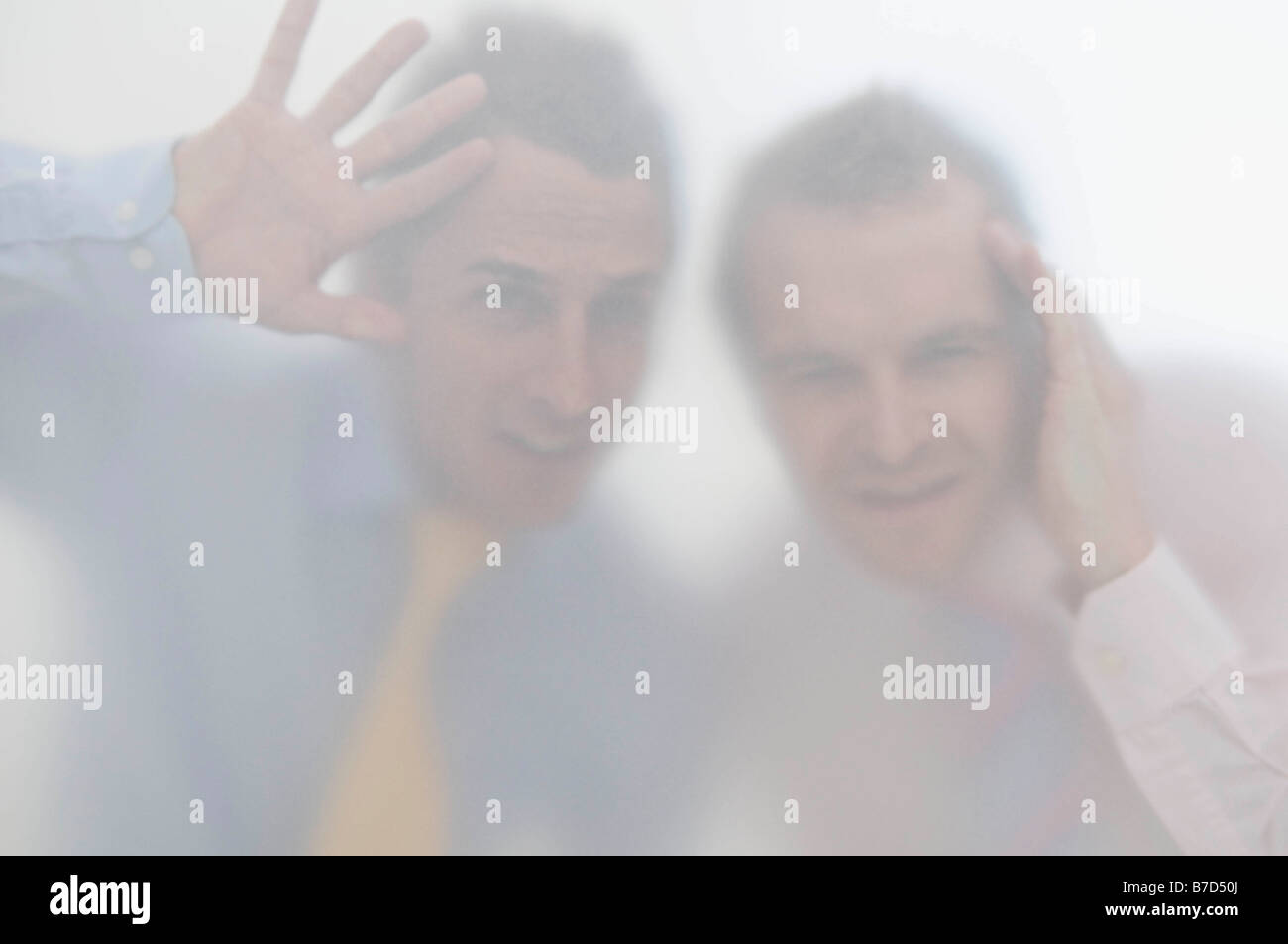 Business men behind a screen - Stock Image