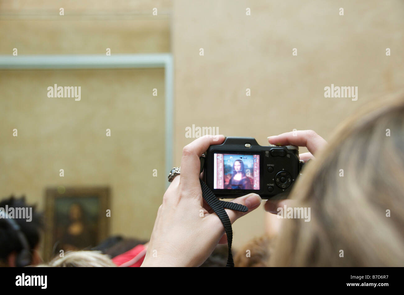 People tacking pictures of Mona Lisa. Louvre. Paris - Stock Image