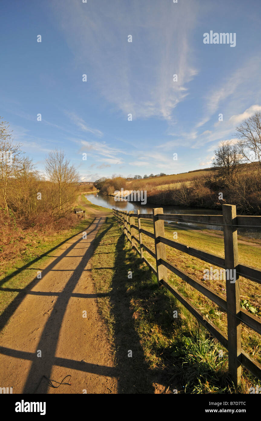 Fence running down to Chesterfield canal towpath - Stock Image