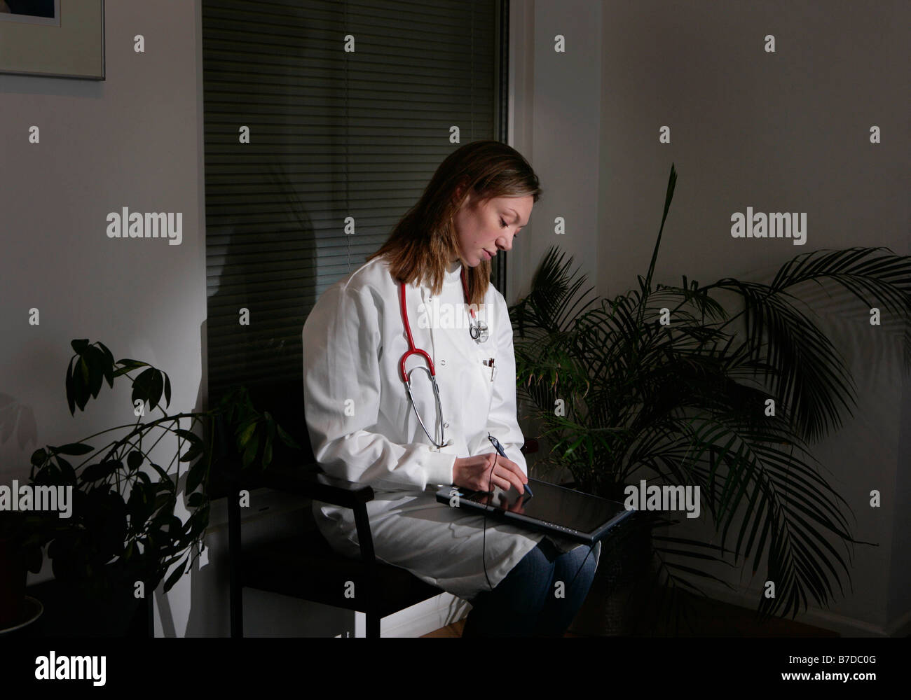 Female doctor using tablet pc Stock Photo