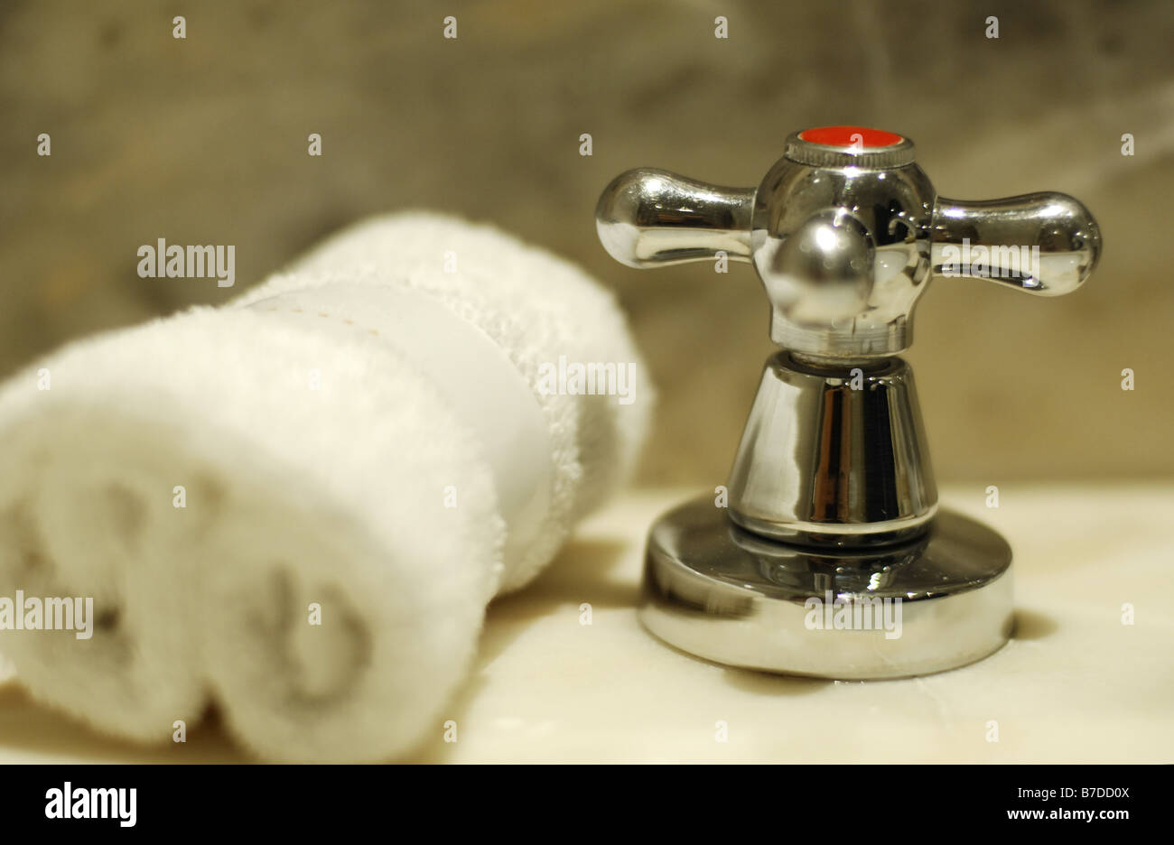 water tap in a marble bathroom - Stock Image