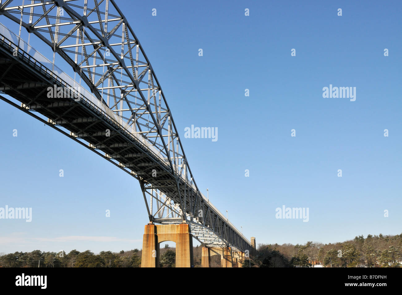 View of steel bridge from below showing beams angles concrete support trusses in a graphic abstract style Bourne - Stock Image