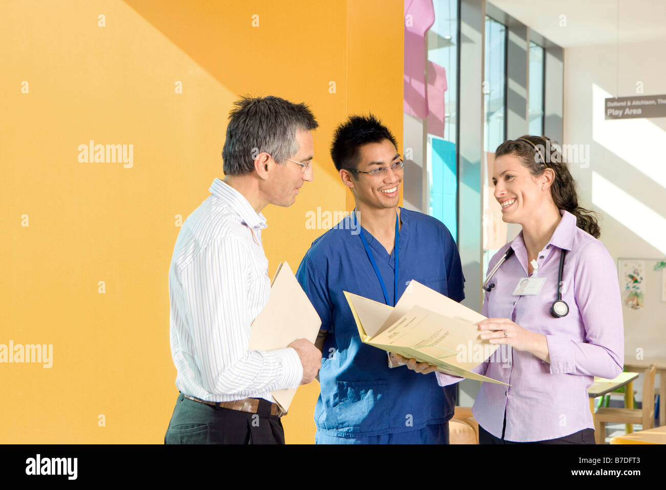 Three medical colleagues talking - Stock Image