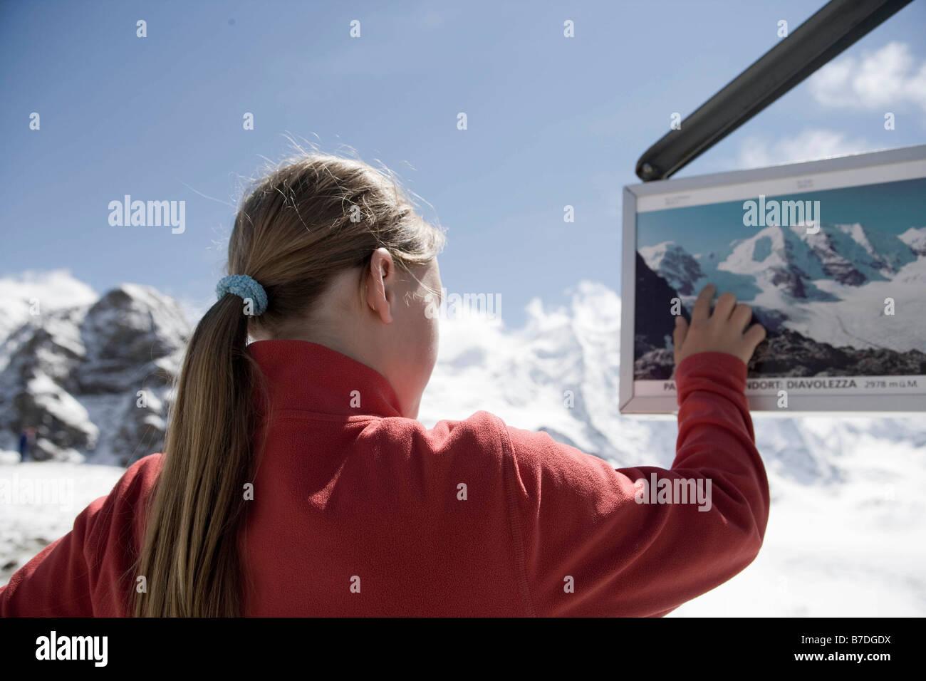 girl looking around in mountainous area - Stock Image