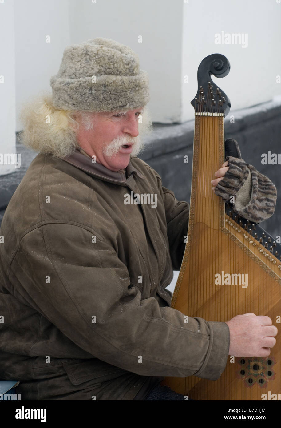 Musician playing the Bandura a string instrument unique to the Ukraine - Stock Image