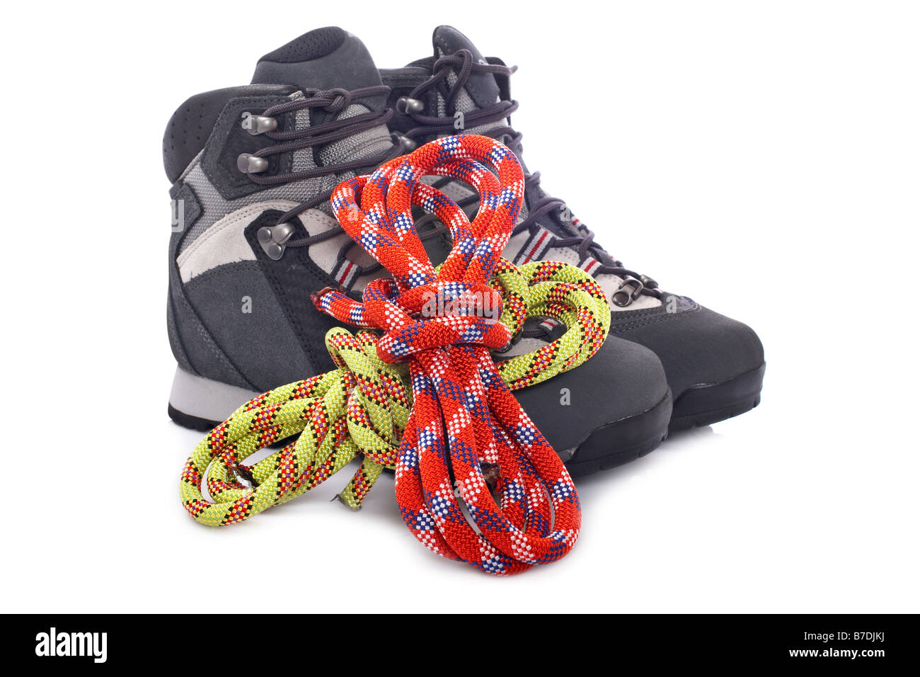 Hiking boots and two rope reflected on white background - Stock Image