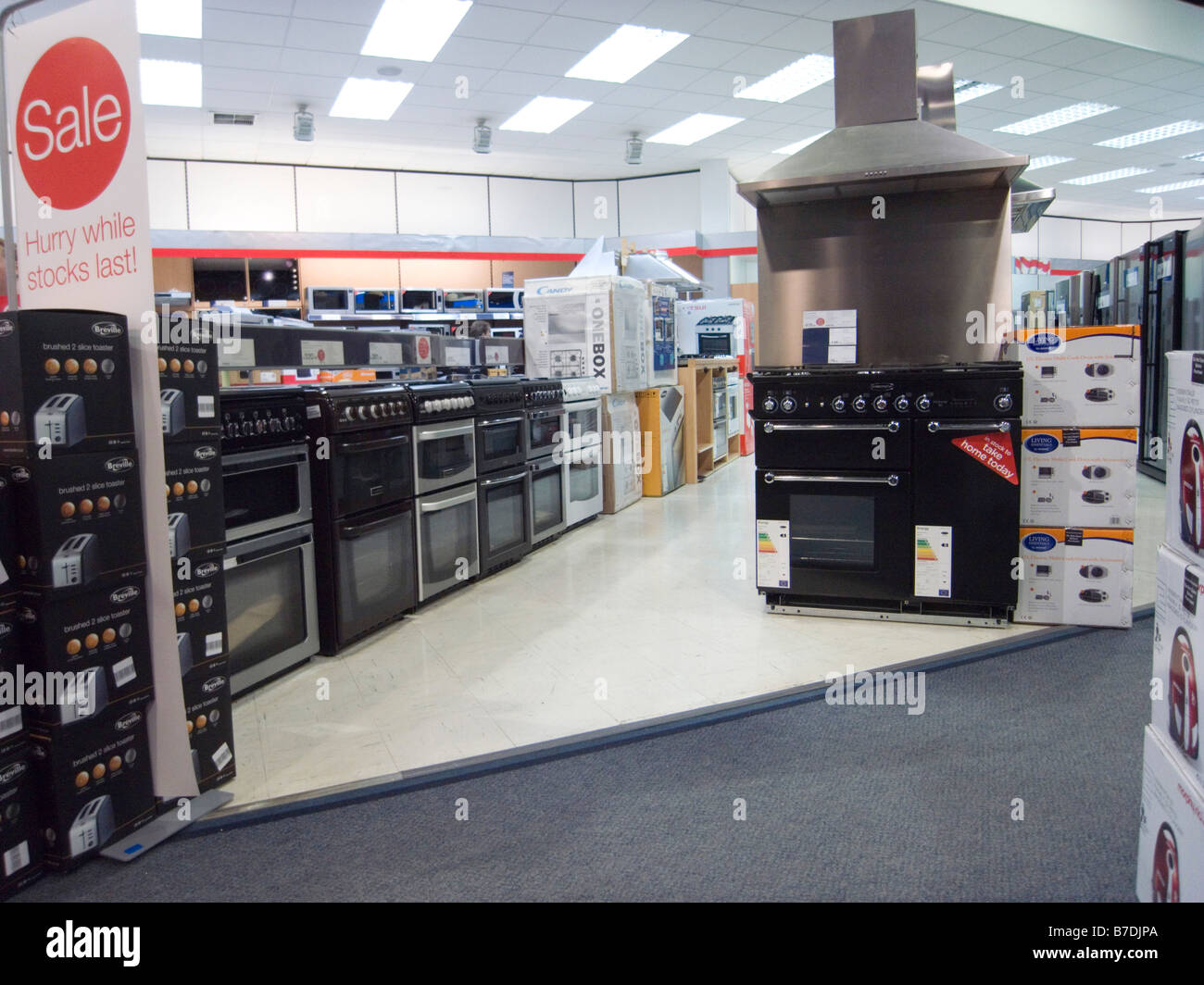 Close Up The cookers for sale in a large electrical retailer - Stock Image