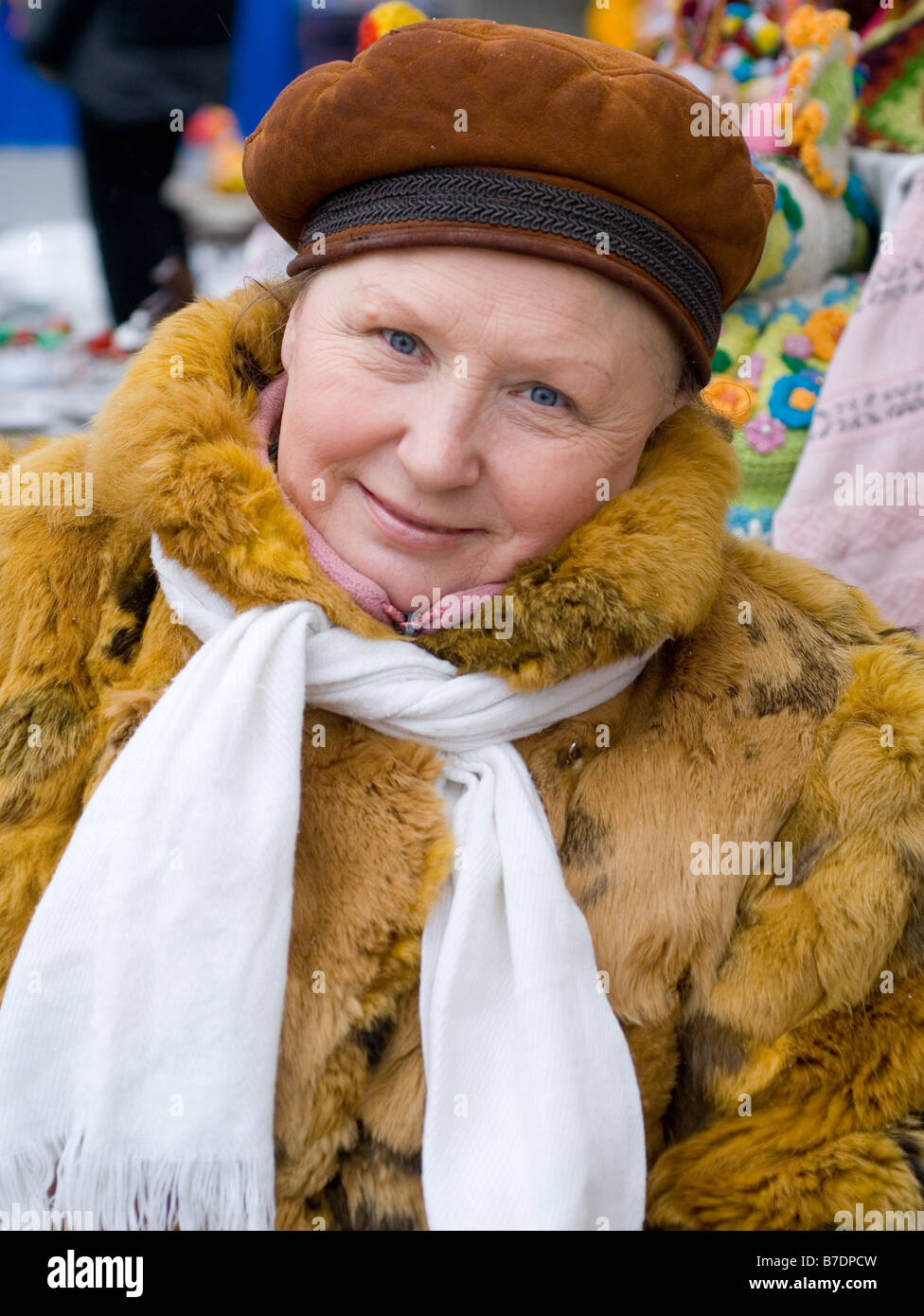 Kiev lady in craft market, Ukraine. Fur coat and winter attire. - Stock Image